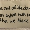 white piece of paper with quote written in black marker