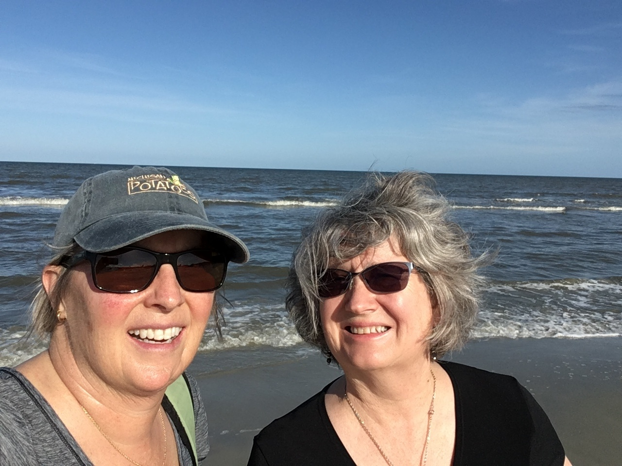 selfie of Kim Vincent and Diane Sontum on a beach with ocean behind