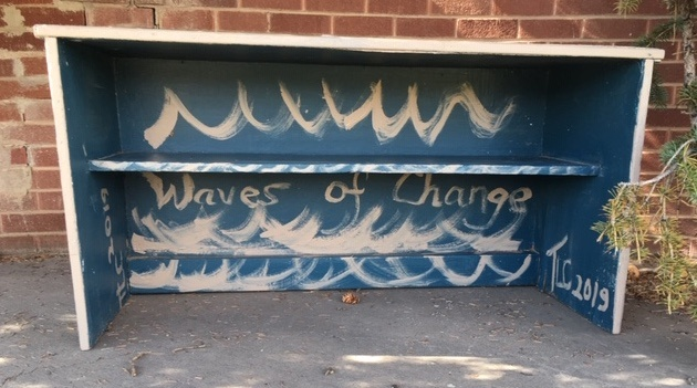 bench painted blue with white waves