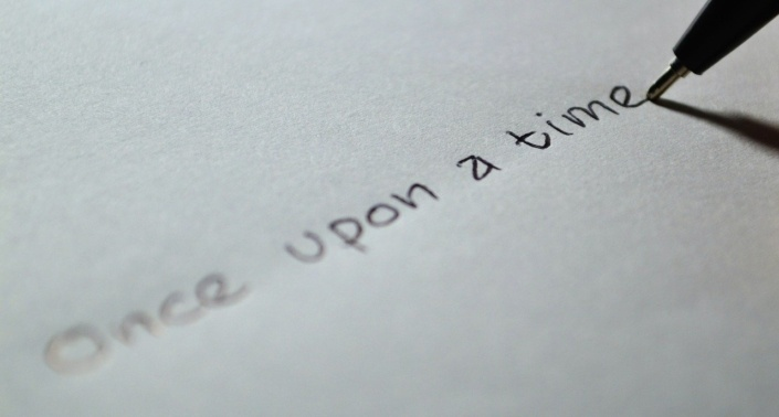 white paper and pen with once upon a time starting a story